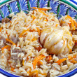 Traditional asian pilaf with garlic — Stock Photo