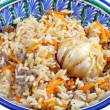 Stock Photo: Traditional asian pilaf with garlic