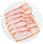 Sliced bacon on white plate — Stock Photo