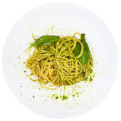 Top view spaghetti mixed with pesto — Stock Photo