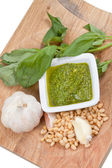 Pesto ingredient on wooden board — Stock Photo