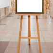 Picture frame on easel in art gallery — Stock Photo #16262529