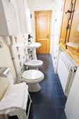 Interior of narrow toilet room — Stock Photo