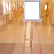 Silver picture frame easel in art gallery hall — Stock Photo #16831467