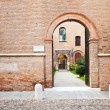 Brick enceinte and ache gate in medieval town - Stock Photo
