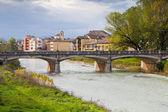View of bridge through Parma stream, Italy — Stock Photo