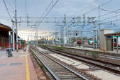 The last train on railroad station in evening — Stock Photo