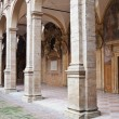 Arcade and courtyard of Archiginnasio palace, Bologna - Stock Photo