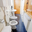 Narrow lavatory room - Stock Photo