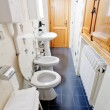 Photo: Narrow lavatory room