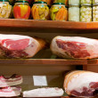 Stock Photo: Hams and salty bacon in small local shop