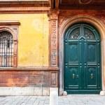 Wooden door of medieval house in Ferrara, — Stock Photo #17329233
