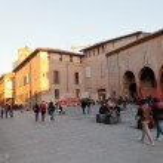 Постер, плакат: Piazza Giuseppe Verdi in Bologna at warm autumn evening