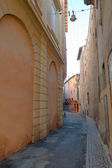 Narrow street in medieval downtown — Stock Photo
