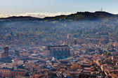 Bird eye view from Asinelli Tower on Bologna with mountain — Stock Photo