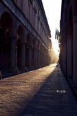 Via Zamboni in University district of Bologna at sunset — Stock Photo