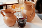 Clay jugs with local red wine — Stock Photo