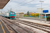 Last train on railroad station — Stock Photo