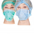 Mannequin doctor heads wearing textile surgical cap and mask — Stock Photo #18152973