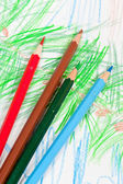 Colored pencils on children picture — Stock Photo