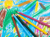 Colored pencils on children draw picture — Stock fotografie