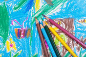 Several colored pencils on children picture — 图库照片