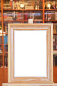 White canvas of wide picture frame on easel in library — Stock Photo