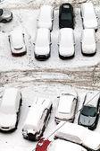 Top view of cars covered with snow on parking — Stock Photo