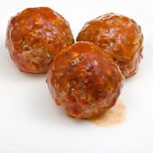 Three meatballs under meat sauce — Stock Photo