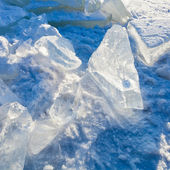 Block of clear river ice in cold winter day under sunbeams — Stock Photo