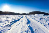 Ski track at snow field in cold winter day — Stock Photo