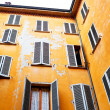 Typical old urban house walls in italian urban patio - Stock Photo