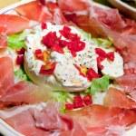 Burrata with parma prosciutto crudo — Stock Photo