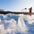 图库照片: Winter swimmers on frozen river