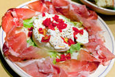 Burrata with parma prosciutto crudo — Stock Photo