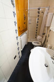 Interior of narrow toilet room — Stockfoto