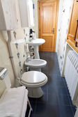Modern toilet room in old italian home — Stock Photo