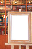 White canvas of wide picture frame on easel — Stock Photo