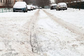 Snow road in residential district — Stock Photo