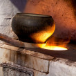 Russian stove and old iron pot — Stock Photo