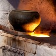 Stock Photo: Russian stove and old iron pot