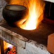 Stock Photo: Russian stove and old cast-iron pot