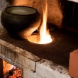 Oven and old cast-iron pot — Stockfoto