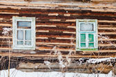 Old timbered wall of rustic house — Stok fotoğraf