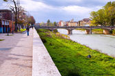 View of bridge through Parma stream, Italy — Stock Photo