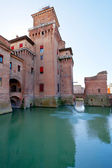 Side view of moat and Castello Estense in Ferrara, — Stock Photo