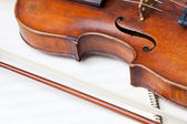 Violin bout and bow on music book — Stock Photo