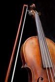 Fiddle neck and bow on black — Stock Photo