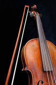 Violin and bow on black background — Stock Photo