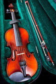 Violin with bow in green velvet case — Stock Photo
